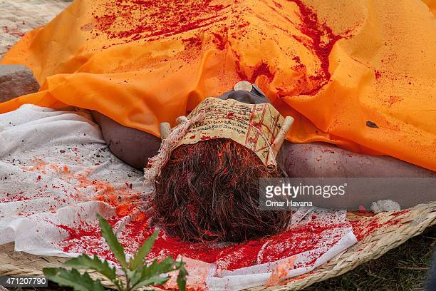 The body of one of the victims of the earthquake that hit Nepal yesterday lays on the ground before cremation on April 26, 2015 in Bhaktapur, Nepal....