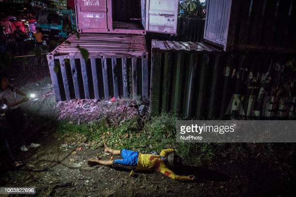 The body of one of two suspected drug dealers who was killed by police during a drug sting operation in Manila Philippines June 8 2018 More than...