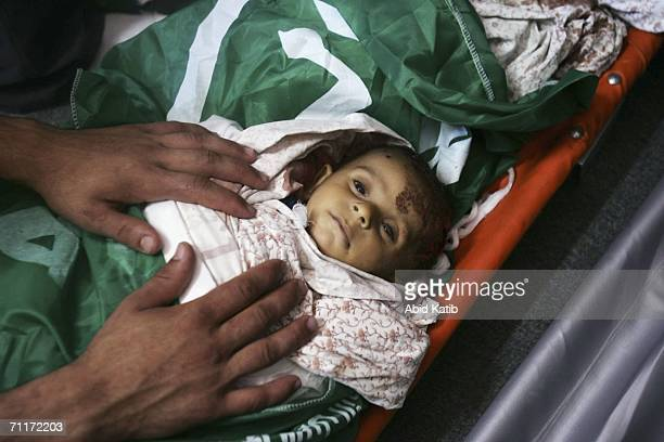 The body of oneyearold Palestinian boy Haitham Gali killed by Israeli strike on a crowded Gaza beach is prepared for his funeral June 10 2006 in Beit...