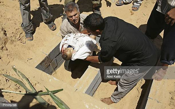 The body of oneyearold Palestinian boy Haitham Gali who was killed yesterday in an Israeli attack is interred during his funeral on June 10 2006 in...