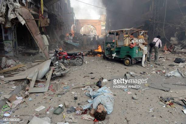 The body of Pakistani blast victim lies at the site of a bomb explosion in the busy Kissa Khwani market in Peshawar on September 29 2013 A bomb...