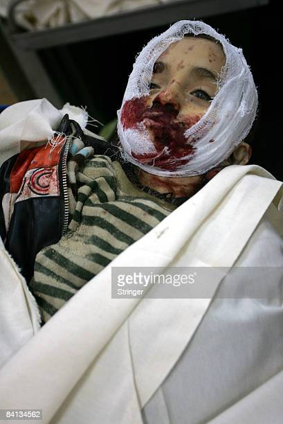 The body of Palestinian child Sodge AlAbse is carried at a hospital morgue on December 29 2008 in Rafah Gaza Sodge AlAbse was killed along with two...
