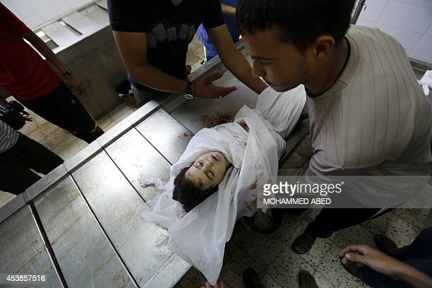 The body of Palestinian girl Nour Abu Hasera is taken for burial from the morgue of a hopsital in Gaza City on August 20 after she was killed in an...