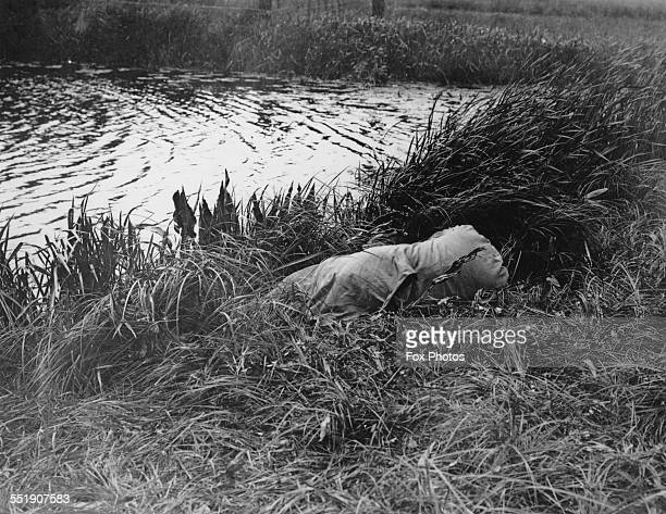 The body of pianist and songwriter Alma Rattenbury on the bank of the River Stour at Christchurch Dorset after her suicide 4th June 1935 She had...