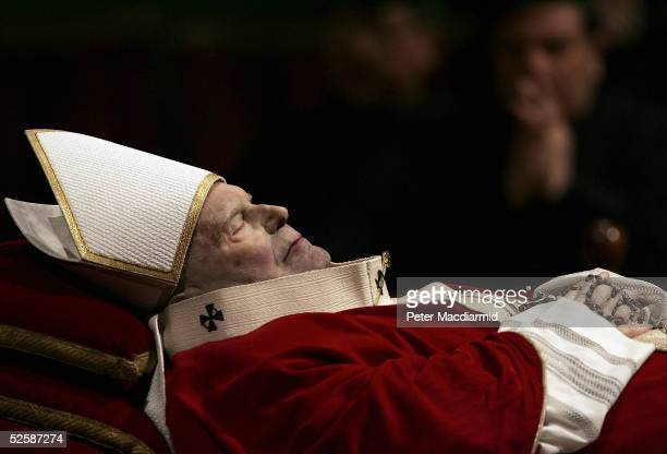 The body of Pope John Paul II lies in state in St Peter's Basilica on April 4 , in Vatican City. The Pope's body will be viewed by the faithfull...
