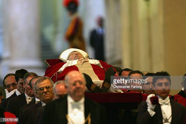 The body of Pope John Paul II makes its way through the Vatican along the stairs and corridor of the Bronze Door on April 4 Vatican City The Pope's...
