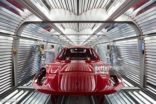 The body of Porsche Panamera luxury automobile stands inside a light tunnel during paint work inspections in the Porsche AG factory in Leipzig...