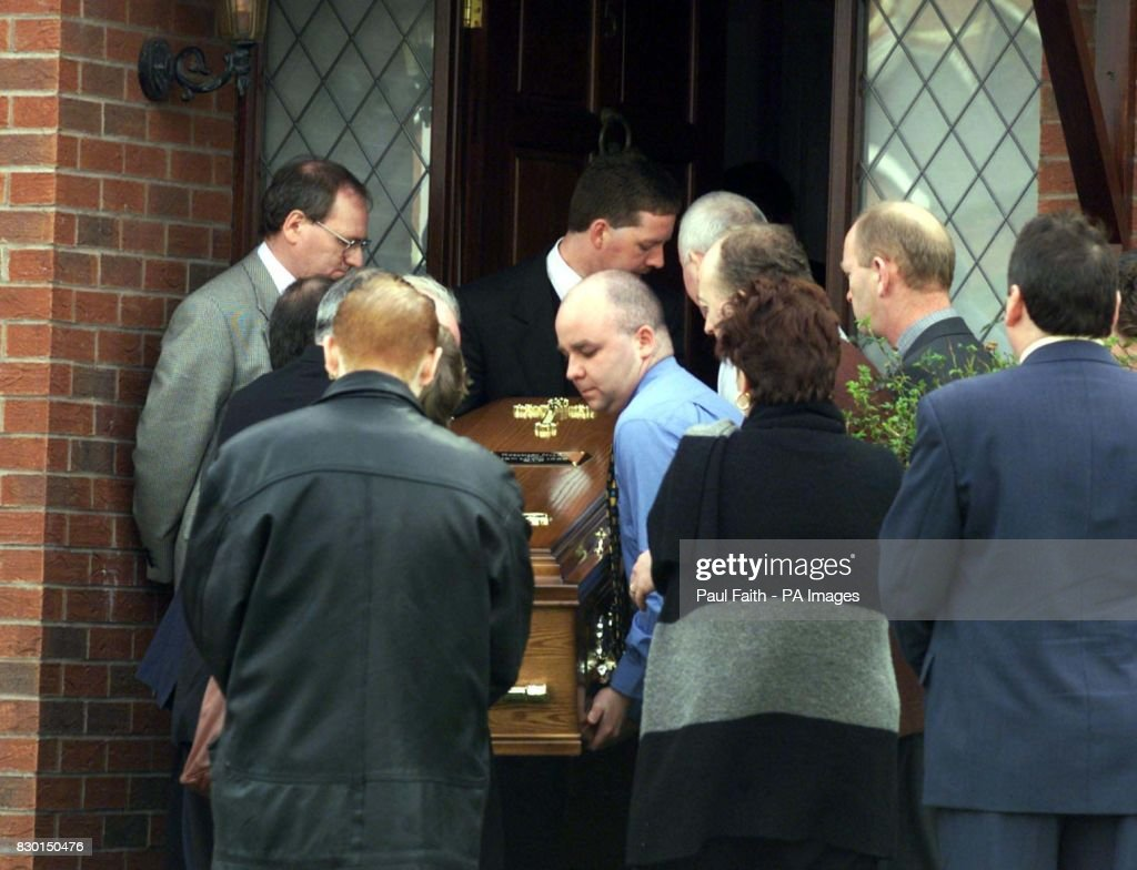 The body of Rosemary Nelson is carried by family back into her home in Lurgan, County Armagh. Nelson, died in hospital from horrific injuries two hours after a booby trap bomb ripped her silver BMW apart as she drove away from her home.