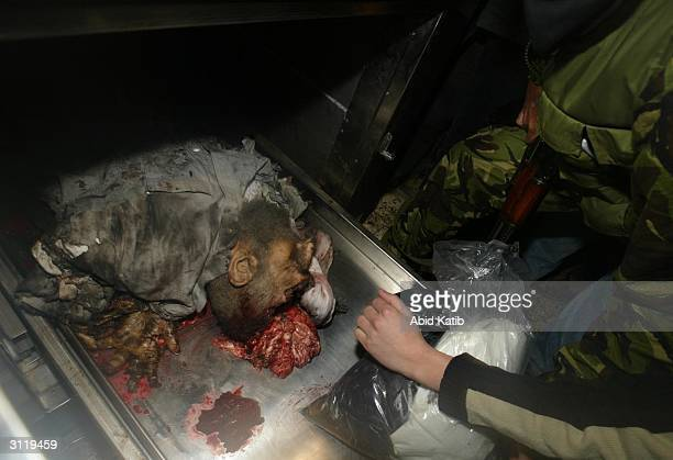 S NOTE GRAPHIC CONTENT The body of Sheikh Ahmed Yassin is seen in the morgue in the Alshifa hospital March 22 2004 in Gaza city in the Gaza Strip...