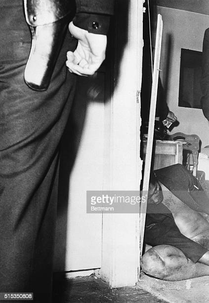 The body of singer Sam Cooke lies slumped in the doorway of a motel manager's apartment According to police he kicked in the manager's door looking...