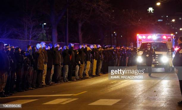 TOPSHOT The body of slain Chicago police officer Samuel Jimenez at the shooting at the Mercy Hospital is being escorted to the Medical Examiner...