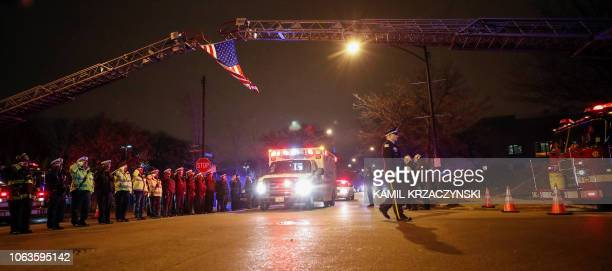 The body of slain Chicago police officer Samuel Jimenez at the shooting at the Mercy Hospital is being escorted to the Medical Examiner Office on...