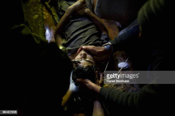 The body of teenager Zahid Farooq is embalmed prior to his funeral procession on February 06 2010 on the outskirts of Srinagar Kashmir India Over a...