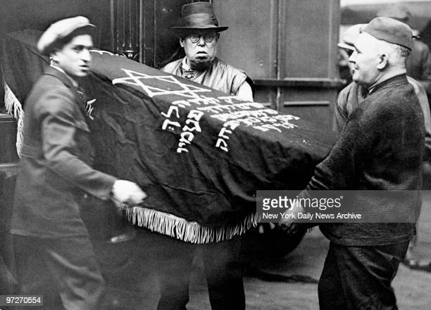 The body of the gangster Jacob Orgen known as Little Augie is carried from the morgue en route to the undertaking parlor