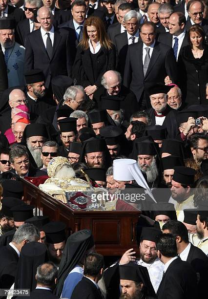 The body of the head of the Orthodox Church of Greece Archbishop Christodoulos followed by Greek politicians is removed from the Athens Cathedral to...
