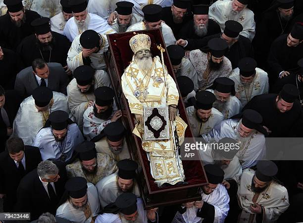 The body of the head of the Orthodox Church of Greece Archbishop Christodoulos is removed from the Athens Cathedral to the Athens 1st cemetery during...