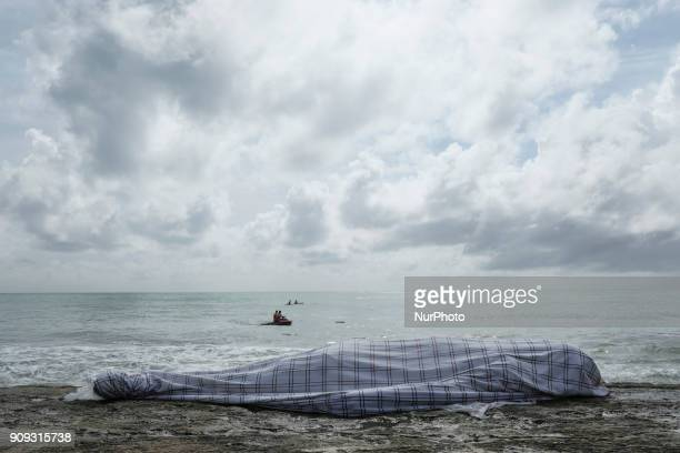 The body of the pilot Daniel Galvão is seen covered He was rescued without life by the residents of the place in Recife Northeast Brazil on January...