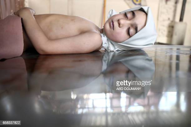 TOPSHOT The body of Yousef a 8yearold boy who was killed by a reported airstrike by the Syrian government forces is seen on March 27 2017 at a morgue...