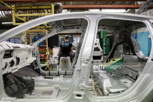 The body shell of a Renault Clio automobile stands on the assembly line inside the Renault SA factory in Flins France on Thursday Feb 23 2017 Carlos...