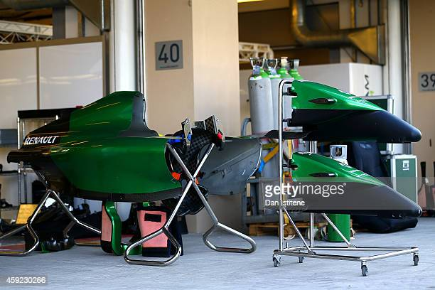 The bodywork of a Caterham is stored outside the team garage during previews ahead of the Abu Dhabi Formula One Grand Prix at Yas Marina Circuit on...