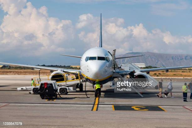 The Boeing 737 of Ryanair budget carrier while passengers leave the place. Flying during the Covid-19 Coronavirus pandemic inside a Boeing 737-800...