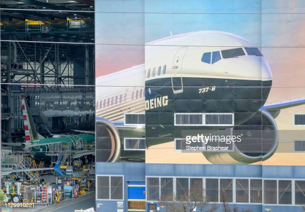 The Boeing 7378 is pictured on a mural on the side of the Boeing Renton Factory on March 11 2019 in Renton Washington Two of the aerospace company's...