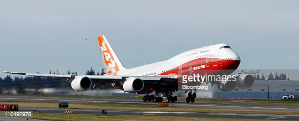 The Boeing 747 8 Intercontinental passenger plane takes off for its first test flight at Paine Field in Everett Washington US on Sunday March 20 2011...