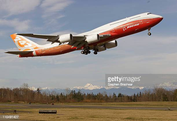 The Boeing 7478 Intercontinental airliner the company's newest and largest passenger plane takes off for its first test flight at Paine Field Airport...