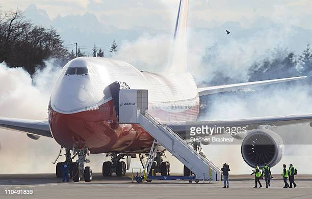 The Boeing 7478 Intercontinental airliner the company's newest and largest passenger plane starts its engines on the runway before it takes off for...