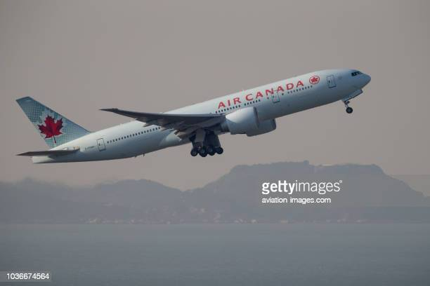 The Boeing 777200 civil jet airplane of Air Canada in the air after departing Hong Kong International Airport China
