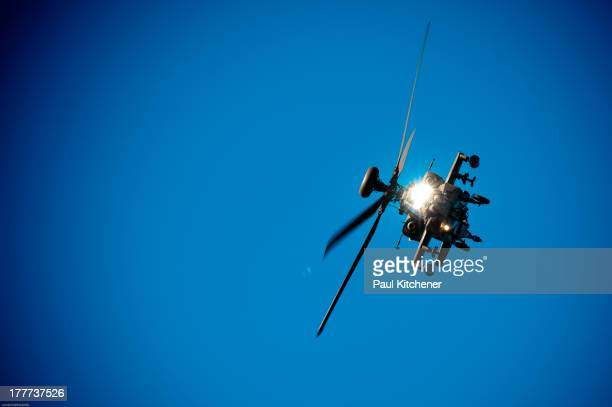 The Boeing AH-64 Apache is a four-blade, twin-engine attack helicopter with tailwheel-type landing gear arrangement, and tandem cockpit for a crew of...