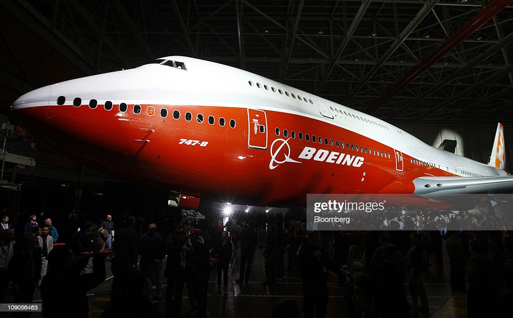 The Boeing Co. 747-8 Intercontinental jumbo jet is rolled out at the company's manufacturing facility in Everett, Washington, U.S., on Sunday, Feb. 13, 2011. Boeing aims for the passenger version of the delayed 747-8 shown to customers and investors today to fly for the first time in March, a little more than a year after the freighter variant. Photographer: Kevin P. Casey/Bloomberg via Getty Images