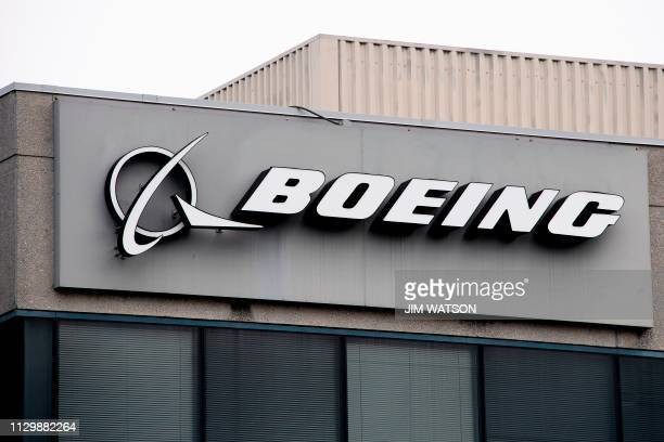 The Boeing Company logo is seen on a building in Annapolis Junction Maryland on March 11 2019 Tumbling shares in US aviation giant Boeing on Monday...