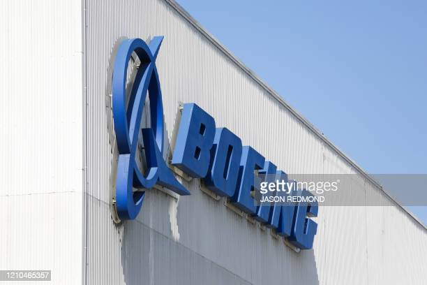 The Boeing logo is pictured at its Renton Factory where the Boeing 737 MAX airliners are built in Renton Washginton on April 20 2020 Boeing announced...