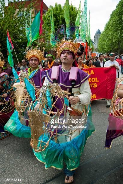 The Boishakhi Mela, a festival in celebration of the Bengali New Year, parading down Brick Lane, London, England, on 10th May 2009.