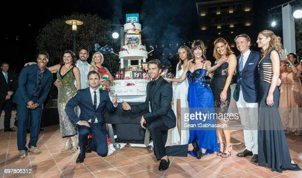 The Bold and the Beautiful cast pose on the dance floor with their 30th anniversary cake Rome Edwards Heather Tom Don Diamont Katherine Kelly Lang...