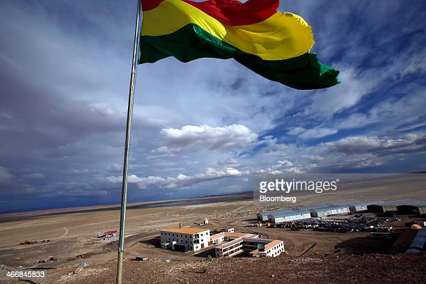 The Bolivian flag flies over at the state mining company Comibol's lithium production plant in Llipe Bolivia on the edge of the Uyuni Salt Flats on...
