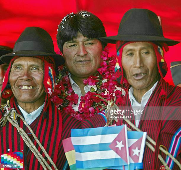 The Bolivian President Evo Morales poses between two 'Amautas' holding little Cuban flags during a ceremony to inaugurate an ew oftalmologic center...