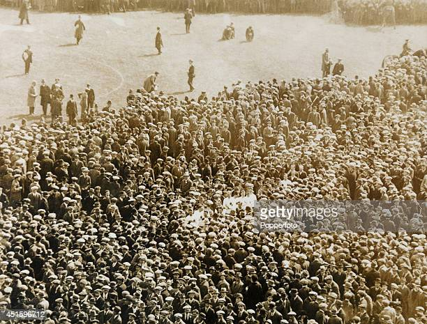 The Bolton Wanderers and West Ham United players trying to leave the pitch through a mass of spectators for the trophy and medals presentations after...