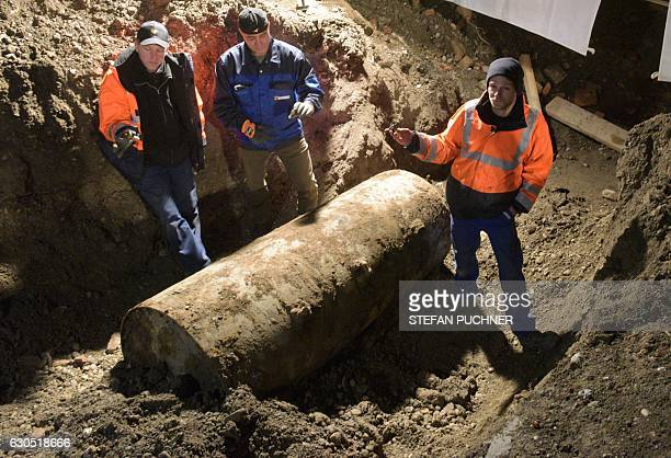 The bomb disposal team stand next to the World War II bomb they made safe in Augsburg southern Germany during a mass evacuation on December 25 2016...
