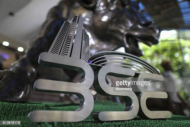 The Bombay Stock Exchange logo is displayed in front of a bronze bull statue in the Bombay Stock Exchange in Mumbai India on Wednesday Oct 5 2016...