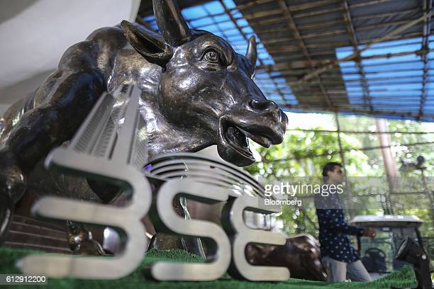The Bombay Stock Exchange logo is displayed in front of a bronze bull statue at the Bombay Stock Exchange in Mumbai India on Wednesday Oct 5 2016...