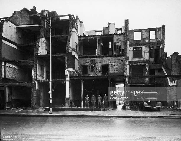 The bombdamaged front of the Grapes tavern on Borough High Street during World War II 27th November 1940