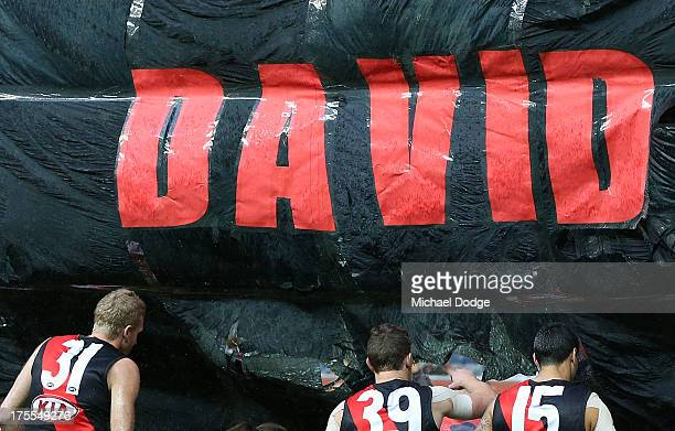 The Bombers banner pay a tribute to former President David Evans during the round 19 AFL match between the Collingwood Magpies and the Essendon...