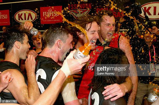 The Bombers celebrate in the rooms after winning the round two AFL match between the Essendon Bombers and the Melbourne Demons at the Melbourne...