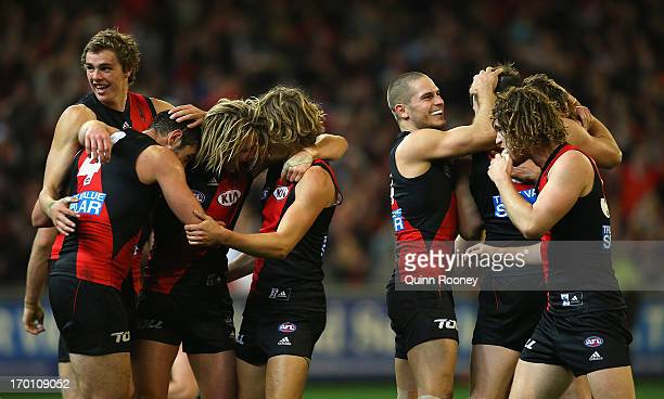 The Bombers celebrate winning the round 11 AFL match between the Essendon Bombers and the Carlton Blues at Melbourne Cricket Ground on June 7 2013 in...