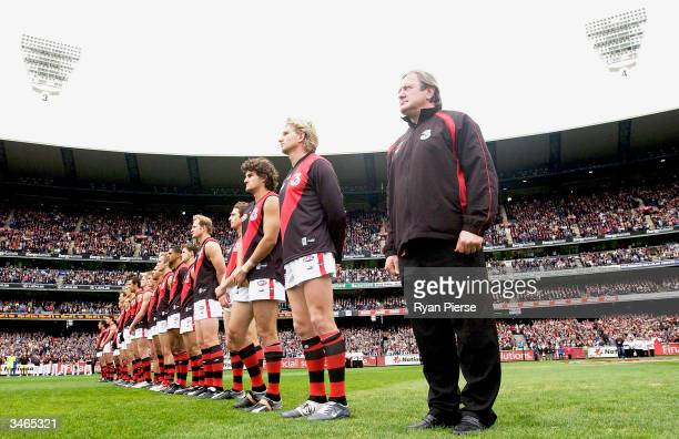 The Bombers line up during a minutes silence to honor Anzac Day before the round five AFL match between The Collingwood Magpies and the Essendon...
