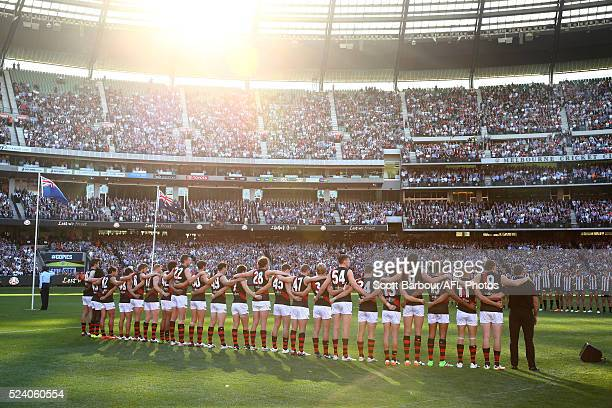 The Bombers line up for the Last Post for ANZAC day during the round five AFL match between the Collingwood Magpies and the Essendon Bombers at the...