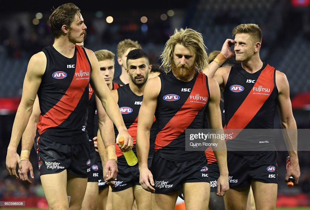 The Bombers look dejected after losing the round 6 AFL match between the Essendon Bombers and Melbourne Demons at Etihad Stadium on April 29, 2018 in Melbourne, Australia.