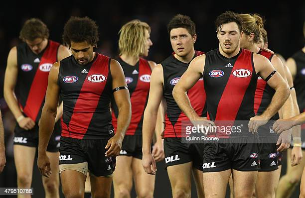 The Bombers looks dejected as they leave the field after losing the round 14 AFL match between the Essendon Bombers and the St Kilda Saints at Etihad...